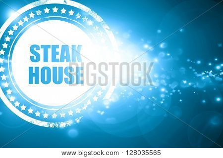 Blue stamp on a glittering background: Delicious steak sign