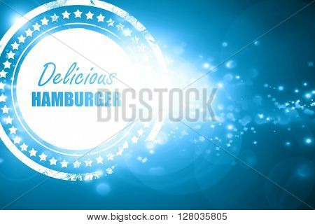 Blue stamp on a glittering background: Delicious hamburger sign
