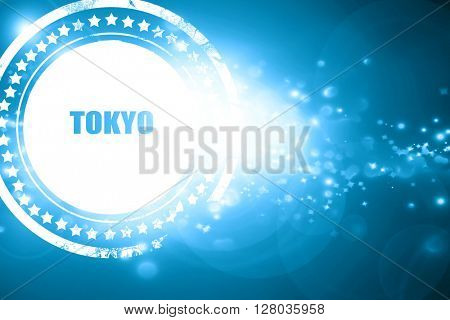Blue stamp on a glittering background: tokyo
