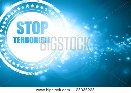 Blue stamp on a glittering background: stop terrorism