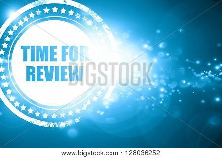 Blue stamp on a glittering background: time for review