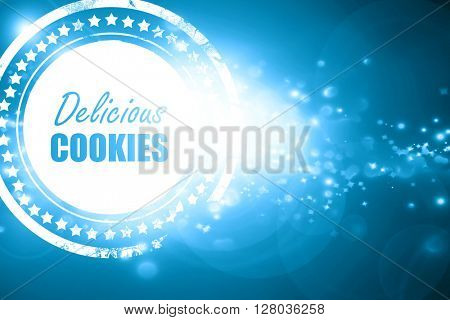 Blue stamp on a glittering background: Delicious cookies sign