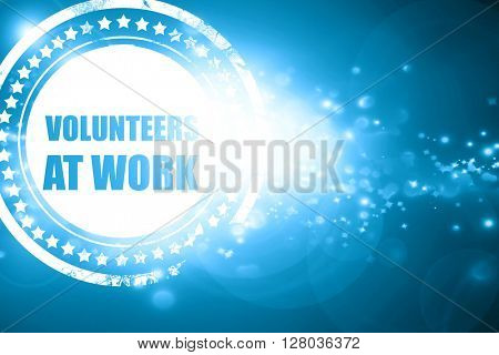 Blue stamp on a glittering background: volunteer at work