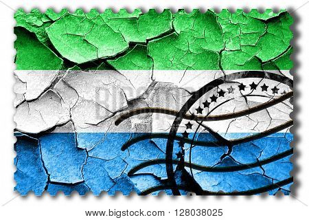 Grunge Sierra Leone flag with some cracks and vintage look
