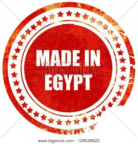 Made in egypt, grunge red rubber stamp on a solid white backgrou
