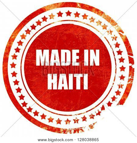 Made in haiti, grunge red rubber stamp on a solid white background