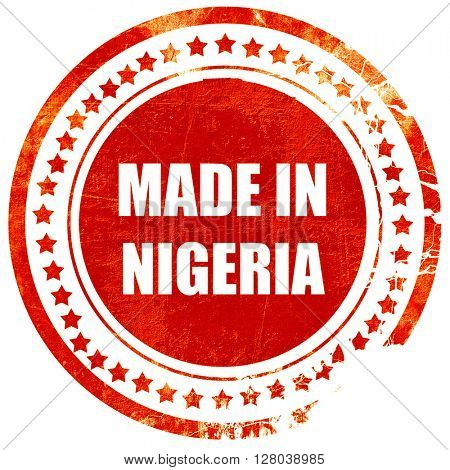 Made in nigeria, grunge red rubber stamp on a solid white background