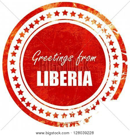 Greetings from liberia, grunge red rubber stamp on a solid white background