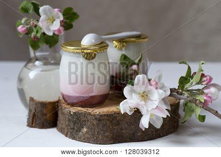 bio strawberry yogurt and blooming apple twig