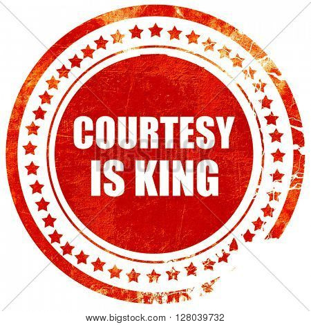 courtesy is king, grunge red rubber stamp on a solid white backg