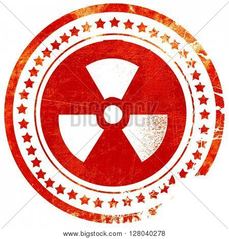 Nuclear danger background, grunge red rubber stamp on a solid wh