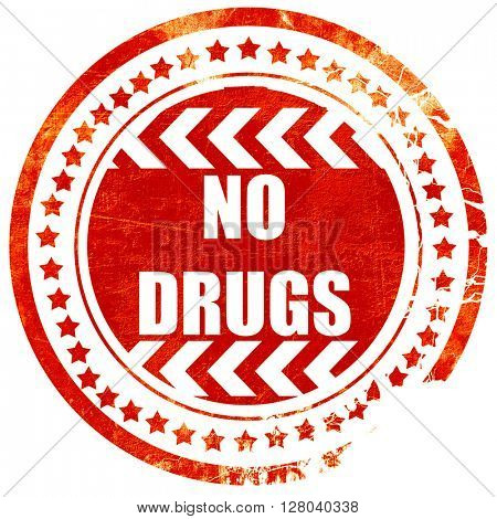 No drugs sign, grunge red rubber stamp on a solid white backgrou