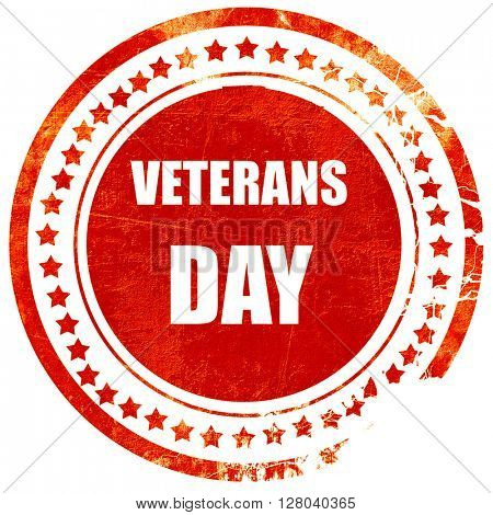 veterans day background, grunge red rubber stamp on a solid whit