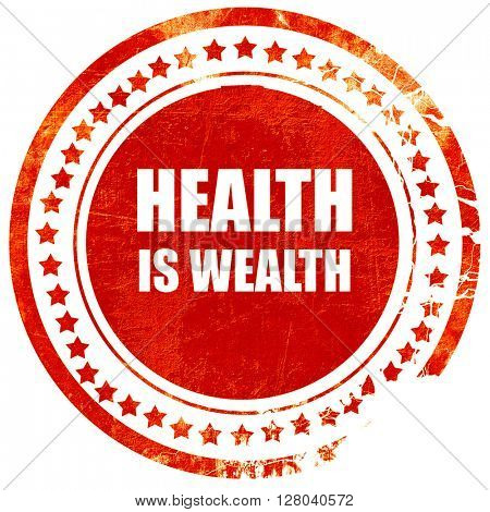 health is wealth, grunge red rubber stamp on a solid white backg