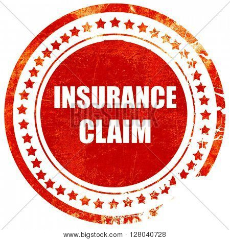 insurance claim, grunge red rubber stamp on a solid white backgr