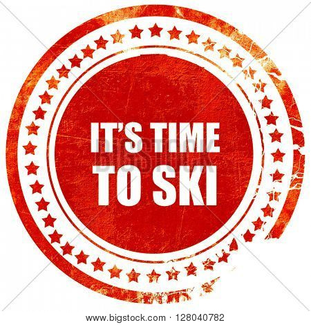 it's time to ski, grunge red rubber stamp on a solid white backg