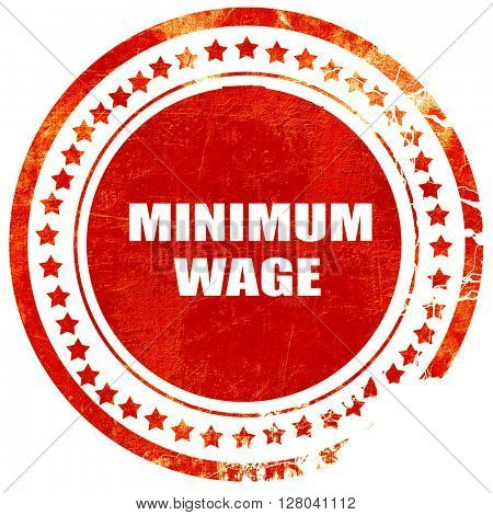 minimum wage, grunge red rubber stamp on a solid white backgroun