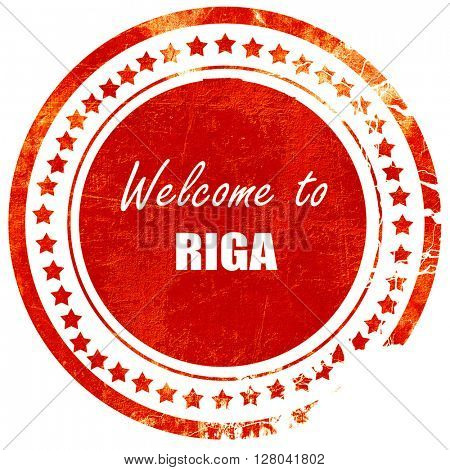 Welcome to riga, grunge red rubber stamp on a solid white backgr