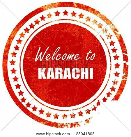 Welcome to karachi, grunge red rubber stamp on a solid white bac
