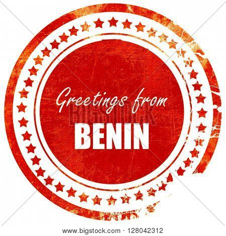 Greetings from benin, grunge red rubber stamp on a solid white b