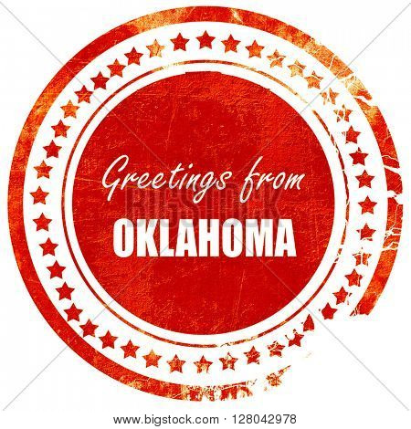 Greetings from oklahoma, grunge red rubber stamp on a solid whit