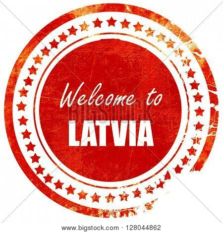 Welcome to latvia, grunge red rubber stamp on a solid white back