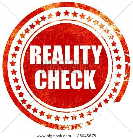 reality check, grunge red rubber stamp on a solid white backgrou