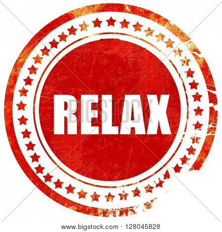 relax, grunge red rubber stamp on a solid white background