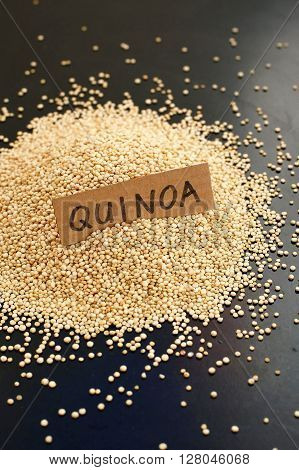 Quinoa With The Label On The Black Background