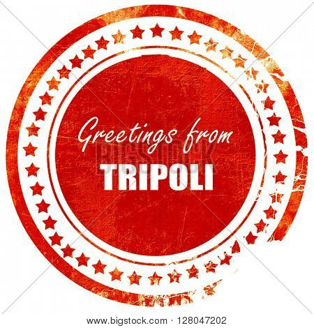 Greetings from tripoli, grunge red rubber stamp  on a solid white background