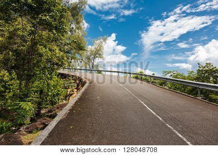 mountain road on blue sky background, Seychelles, Mahe island