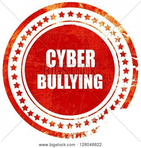 Cyber bullying background, grunge red rubber stamp on a solid white background