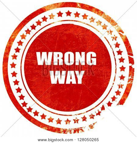 wrong way, grunge red rubber stamp on a solid white background