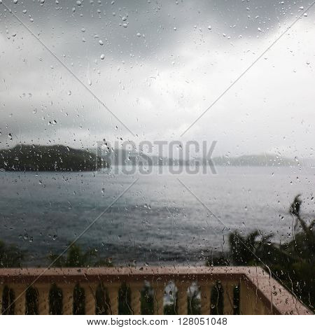 terrace in the colonial style in the rain with an ocean view, Seychelles