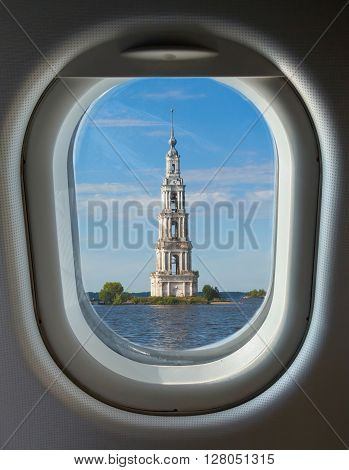 porthole and landmark bell tower of the Cathedral of St. Nicholas flooded a sunny day in summer
