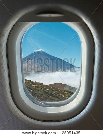 porthole and landmark crater of the volcano Teide in the background on a sunny day