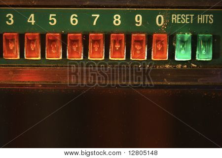 Close-up of jukebox play buttons.