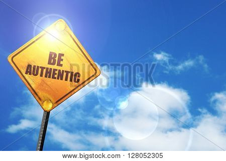 Yellow road sign with a blue sky and white clouds: be authentic