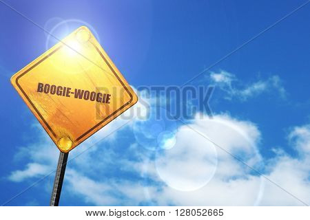 Yellow road sign with a blue sky and white clouds: boogie woogie
