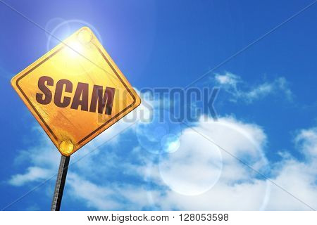Yellow road sign with a blue sky and white clouds: scam