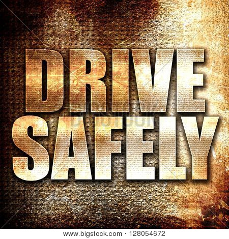 drive safely, written on vintage metal texture