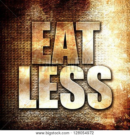 eat less, written on vintage metal texture