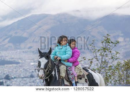 Two Girls Riding A Horse Quito Ecuador