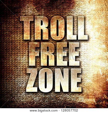 troll free zone, written on vintage metal texture