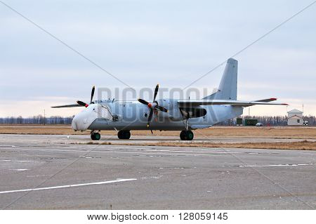 Military transport aircraft parked at the airbase