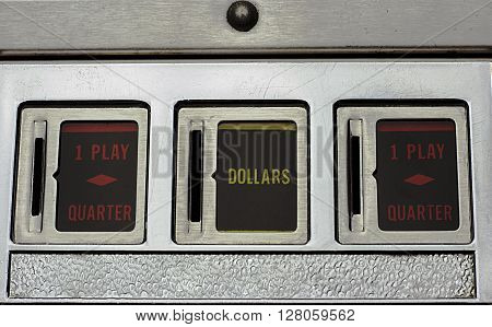 Three coin slots of a Pinball Machine ** Note: Visible grain at 100%, best at smaller sizes