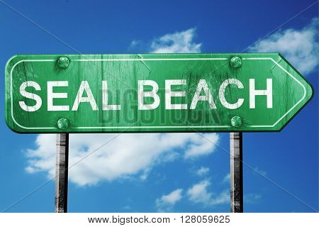 seal beach road sign , worn and damaged look