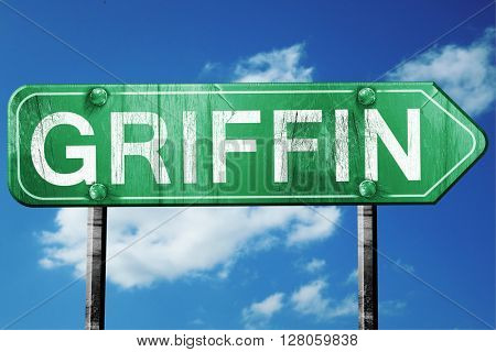 griffin road sign , worn and damaged look