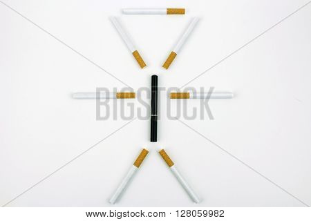 Cigarettes surrounding an e-cigarette to look like the outline of a person