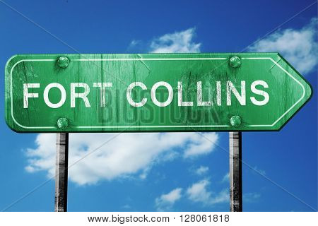 fort collins road sign , worn and damaged look